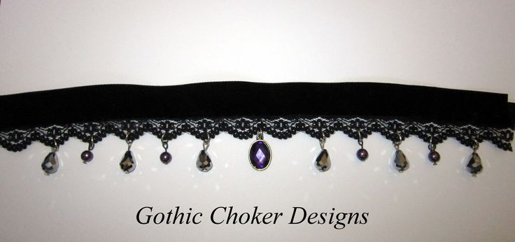 Black velvet and lace choker with purple central stone and purple and silver glass crystals all around the choker. Only R120 approx $12.  Purchase here: https://hellopretty.co.za/gothic-choker-designs/black-choker-with-purple-and-silver-crystals