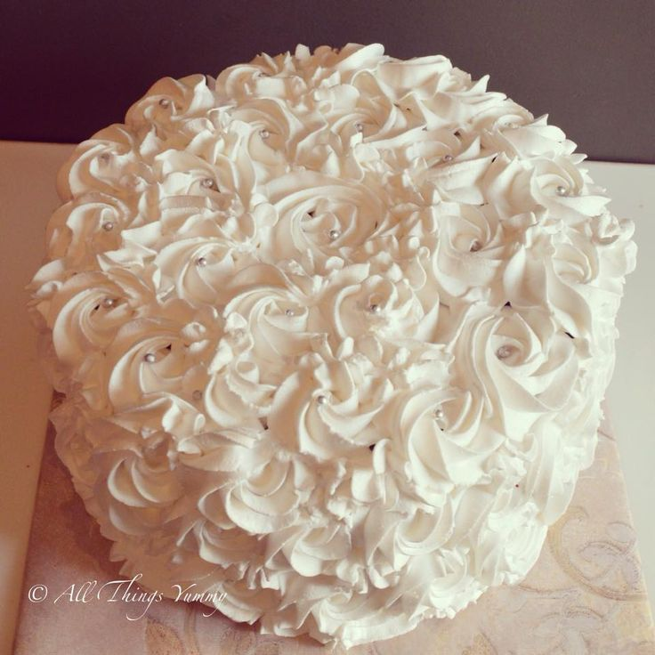 Cakes Decor Rosettes - A White Rosettes Decor Cake | All Things Yummy #allthingsyummy #pink #rosettes #cake #icing #buttercream White #rosettes cake.. #redvelvet inside #whippedcream #white #cake #pretty #classic #nofondant #atyummy #flowers #birthday #creamcheese #layeredcake