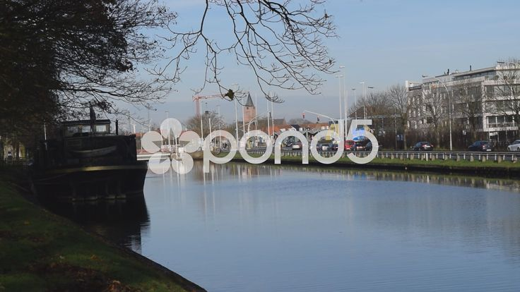 Wide canal with busy road behind it in Bruges, Belgium. With Sound - Stock Footage | by glenman77