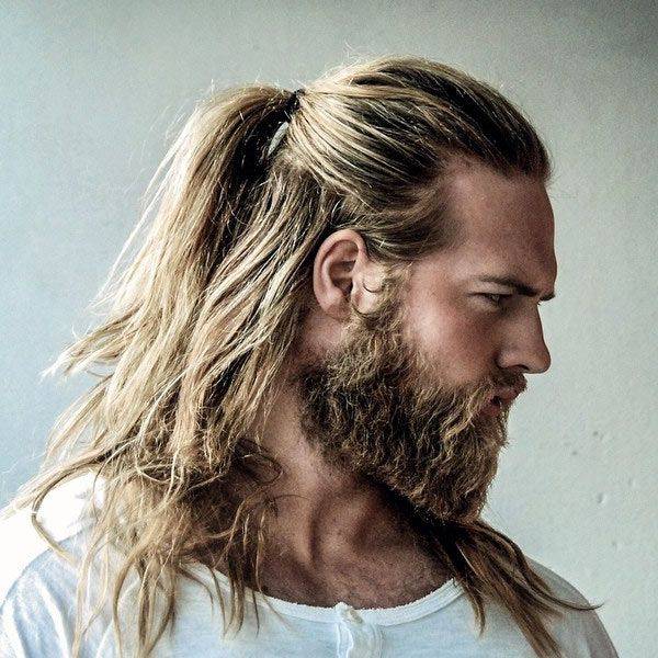 Love this half pony-tail and the square cut beard fading into his furred chest