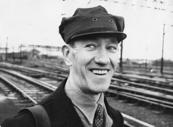 Train driver Jack Mills (1905 - 1970) returns to work after 39 weeks of sick leave, 12th May 1964. Mills was beaten with an axe handle during the 2.6 million pound Great Train Robbery committed at Ledburn, Buckinghamshire, on 8th August 1963. In May 1964, train driver Jack Mills returned to work after sick leave. He died of leukaemia in 1970