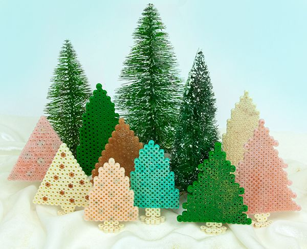 Create a frosty winter forest of sparkling evergreens when you add glitter to your Perler beads before fusing. These trees make a great holiday decoration for a mantel or table, and they're quick and easy to do!