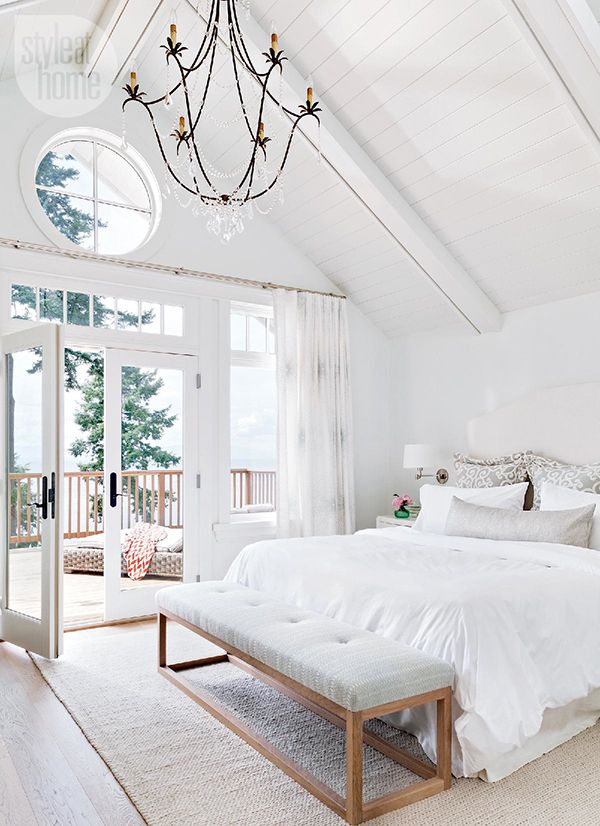 gorgeous white bedroom. love the pillows and that gray and wood bench