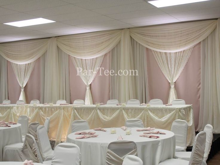 Custom Wedding Décor Featuring Blush and Ivory Backdrop and Ivory Chair Covers