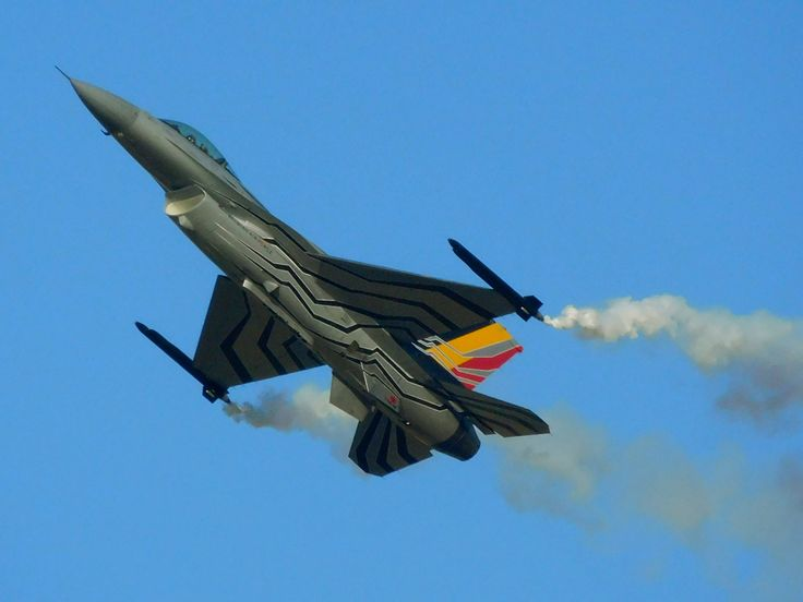 Belgian F-16 flying slowly with its nose up.