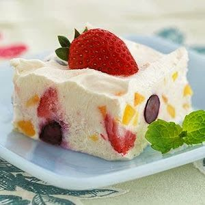Peach-berry Frozen Dessert - Using fat-free cheese and yogurt plus light dessert topping help keep this chilled fruit dessert recipe low in calories, carbs, and fat.