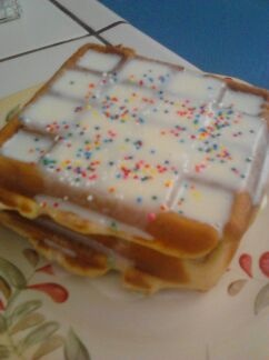 Cake Batter Waffles  1 box 9oz cake mix the smaller ones for a dozen cupcakes I used the spinkle one.  1 1/2 cups flour  2 eggs  1tsp baking soda   2Tbs oil  slowly add enough milk to make it look like pancake batter  Then just cook like you would waffles.  For the topping I added just enough milk to a can of store bought frosting until it looked like syrup. Then added sprinkles to top it off. Family loved them