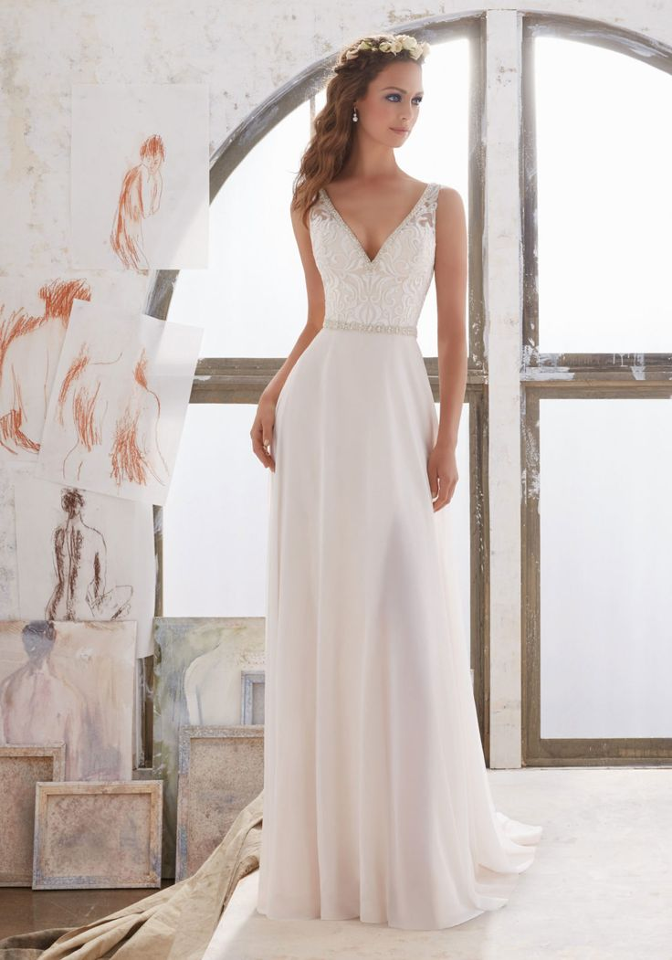 Morilee by Madeline Gardner 'Marjorie' 5505 | Simply and Elegant, This Georgette Sheath Gown Features an Embroidered Bodice with Illusion Side Insets and Crystal Beaded Trim. Deep V Neckline and Back. Colors Available: Diamond White, Ivory/Nude. Shown in Ivory/Nude.