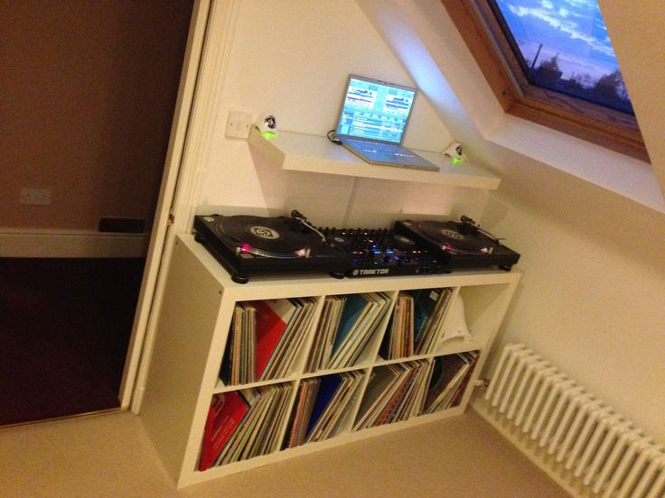 Loft conversion with gap for DJ equipment, Technics 1210, Traktor Kontrol S4 and a MacBook Pro.