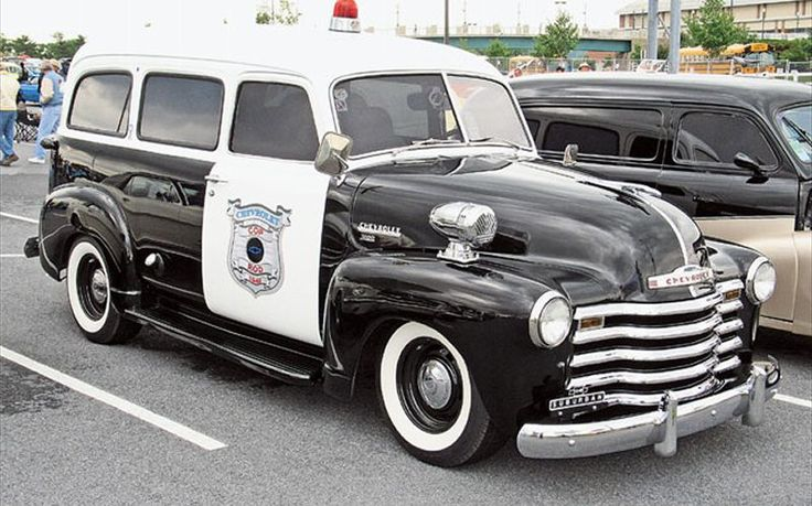 1951 Chevy Suburban used as a service vehicle. The wide white wall tires make it the coolest semi-van around sans the cherry on top & Police insignia on the sides!