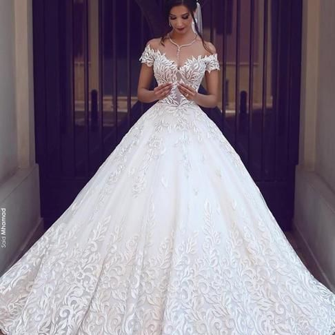 A first for White by Vera Wang, this ball gown is crafted with over 15 yards of …