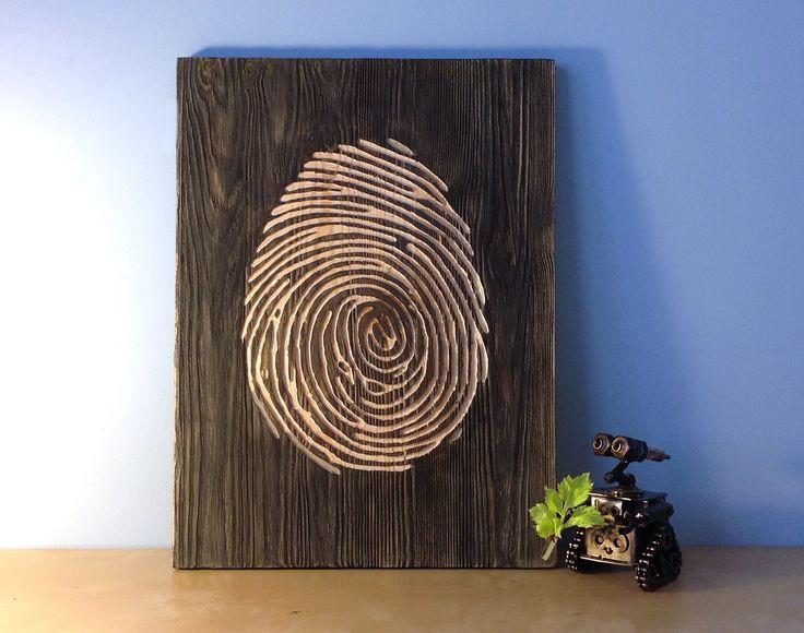 Faithful WALL-E reminds that it necessary protecting the nature and each other.  Otherwise from mankind will be stay only fingerprints... Выгравированное вручную изображение отпечатка пальца на деревянной доске, 30х40 см. SALE Наводит на размышления о сущности человечества, спиралевидных галактиках и открытиях новых миров.  .. #woodposter #дактилоскопия #fingerprint #decor #interior #walle #wally #робот #robot #космос #спираль #вывеска #валли