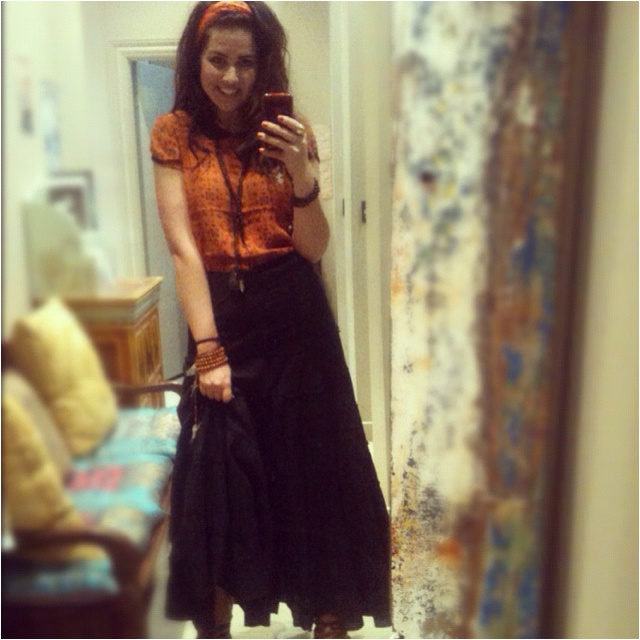 Becky in a black tiered skirt, teamed with an printed orange Alexa top and a small orange ram ram worn as a head scarf. If your gonna wear black you gotta make it shine!  Becky does it well!