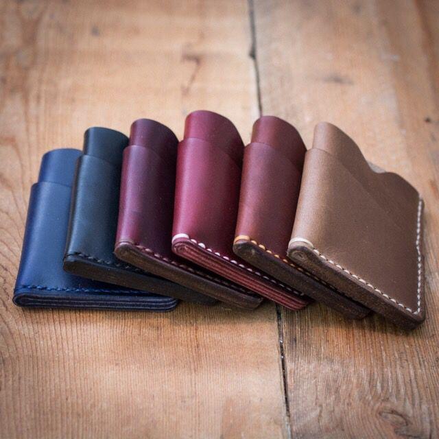 From left to right: navy, black, burgundy, cherry, tan and driftwood CXL cardholders.  #mensstyle #mensfashion #womensfashion #canada #leather #buyfolk #etsy #leatherwallet #handmade #leatherworking #supportlocal #leathercraft #leatherwork #buylocal #leathergoods #madeincanada #popovleather #leatherworks #wallet #leatherbag #handmadewithlove #handmadeaccessories #handmadeshop #handmadebyme #everydaycarry #edc #pocketdump #burgundy #navy