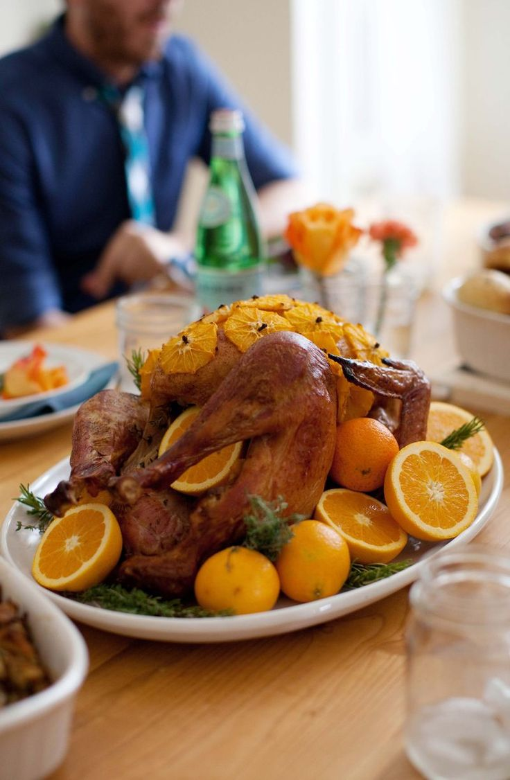 oranges & herbs brined & roasted turkey w/ chicken stock, blue moon beer, brown sugar, black peppercorns, onion, orange rinds, fresh rosemary, thyme & sage & olive oil, garnish w/ orange slices & whole cloves