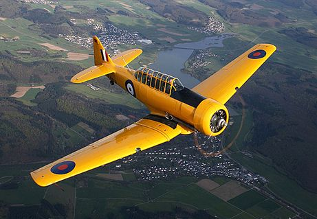 This photograph shows the bright yellow colour that training planes were painted during World War Two, so they could be distinguished on the ground and in the air.