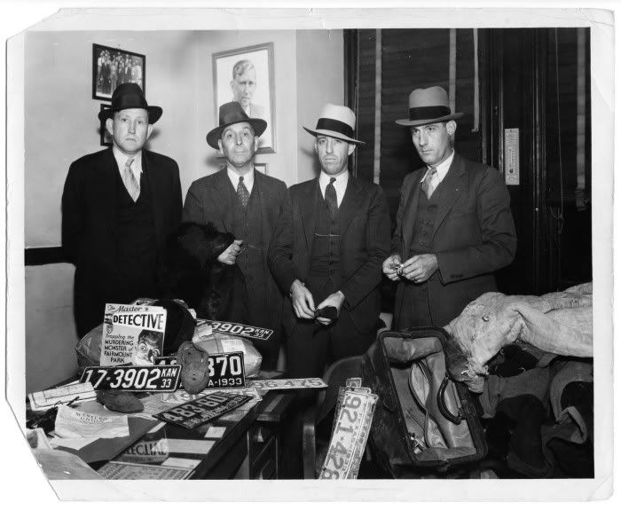 these Dallas Co. deputies posing with items from Clyde Barrow's car
