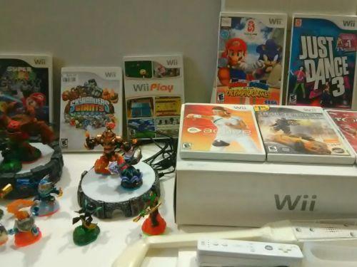 #Nintendo Wii White Console BUNDLE  Games Controllers, Nunchuk. Skylanders HURRY