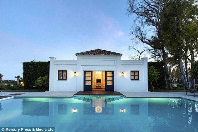 Luxury home: The villa boasts two swimming pools - as well as a poolhouse...