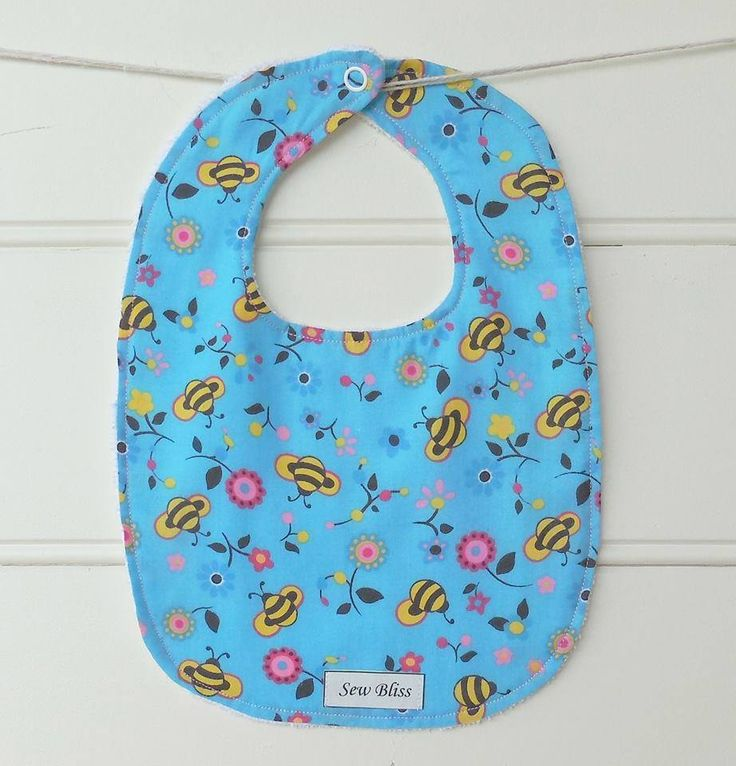 Handmade by Sew Bliss. Baby girls flowers and bees bib.