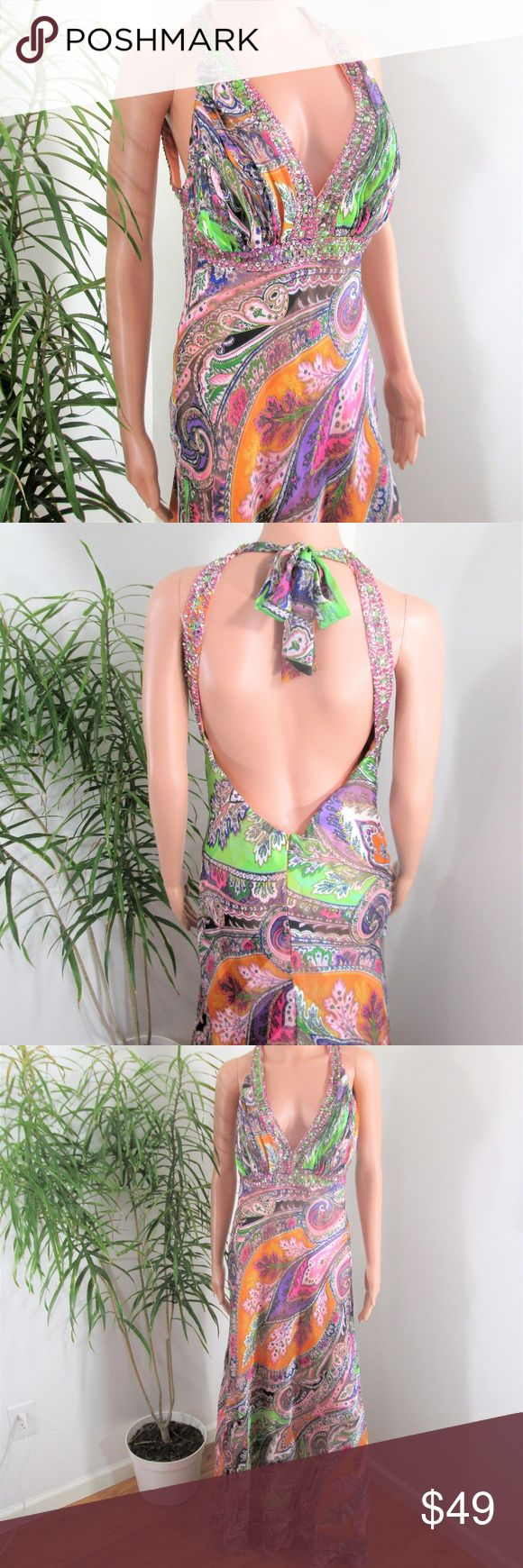 """Ignite Evenings* Multi Color Backless Maxi Gorgeous satiny gown trimmed with  sequins & rhinestones on straps &  across bodice. Deep V halter, zip & tie back. Bell skirt with flounced hem. Full pale peach lining. Paisley print in lilac, purple, rose, pink, green, gold, apricot.  Measured flat, 16"""" pit to pit. 14"""" across waist. 59"""" long from shoulder to hem. Model is 5' 9'', dress touches floor.  Vacation Cruise Special Occasion Prom HOCO  in EUC Ignite Evenings Dresses Backless"""