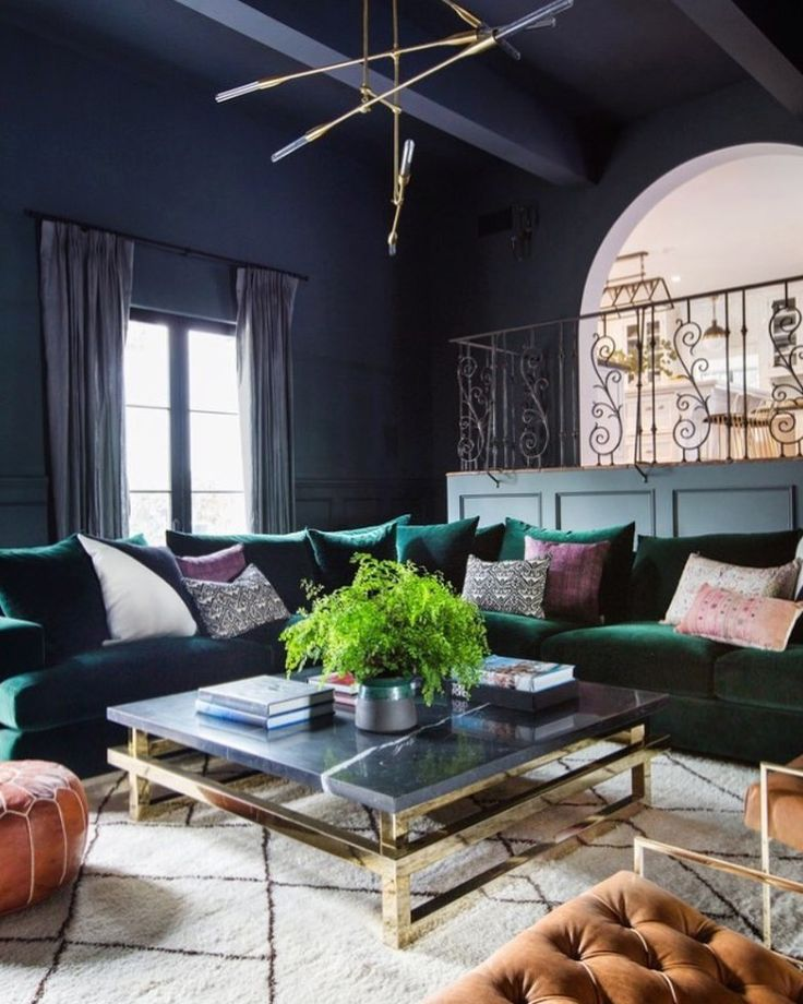 Shay Mitchells Moody Living Room With Gray Walls A Gold Chandelier And Velvet Green Sectional