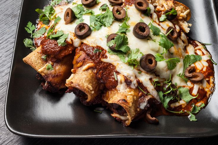 A vegetarian black bean and cheese enchiladas recipe with red chile salsa.