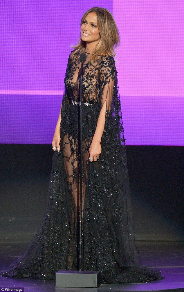 See-through: The singer's beige bra was clearly visible under her sheer black gown...
