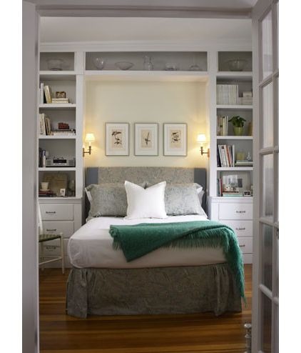 Shallow built-in shelving can help you gain storage and maintain floor space. Stick to shelving that's no more than 12 inches deep. The units here act as bedside tables, eliminating the need for extra furniture. Recessing the bed in the middle of the shelving prevents it from encroaching on much-needed floor space
