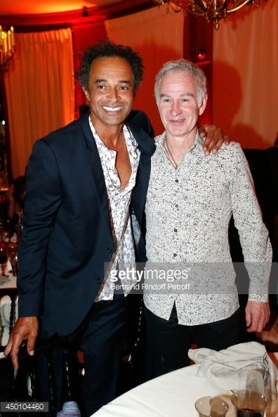 News Photo : Former tennis players Yannick Noah and John...