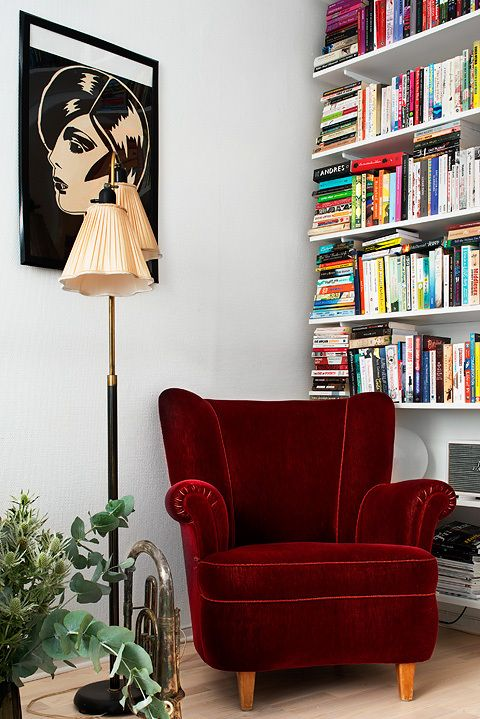 Love this velvet reading chair and beautiful bookshelf. Great decorating ideas from BookBub.