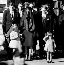 As the caisson bearing his father's casket passed by, three-year-old John Kennedy Jr salutes the coffin of his assassinated father, President John F. Kennedy, outside St. Matthew's Cathedral in Washington, DC after the elder Kennedy's funeral. The famous picture, memorializing his poignant tribute, was taken on the same day as John's third birthday.