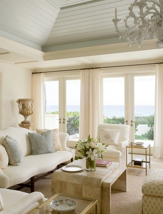 White, gold tones, pale blue and celery green love the coffee table and curtain rod