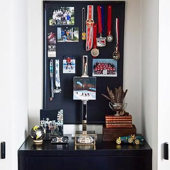Boys Closet with Black Dresser and Pin Board