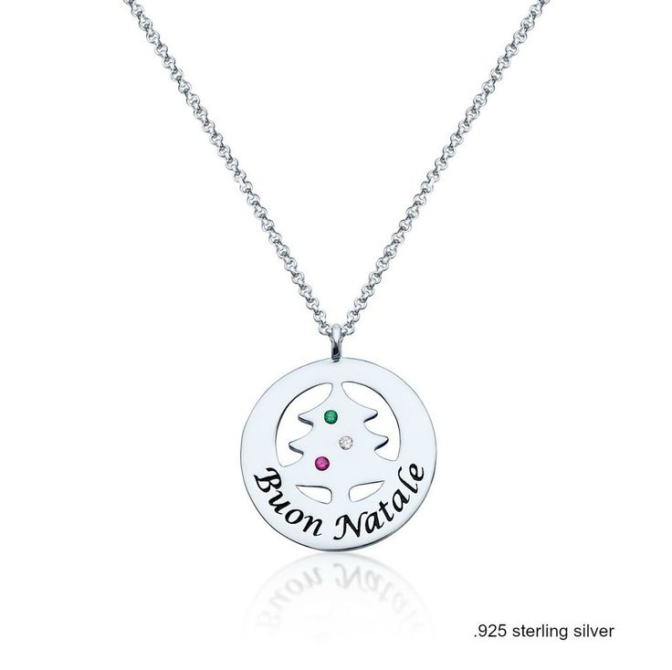 """Three tiny jewels in Italian colors sparkle from a little Christmas tree.   Inscribed with the Italian words for """"Merry Christmas,"""" it welcomes the holiday season.  Perfectly.  .925 Sterling Silver by Cento Designs Pendant: .75"""" wide (approximately the width/size of a nickel) Chain type: cable"""