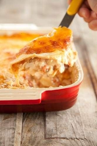 Paula deen mexican chicken casserole!  1 can cheddar cheese soup 1 can cream of chicken soup 1 can cream of mushroom soup 4 cups cubed or shredded chicken Can of rotel or tomatoes  Green chilies  Tortillas