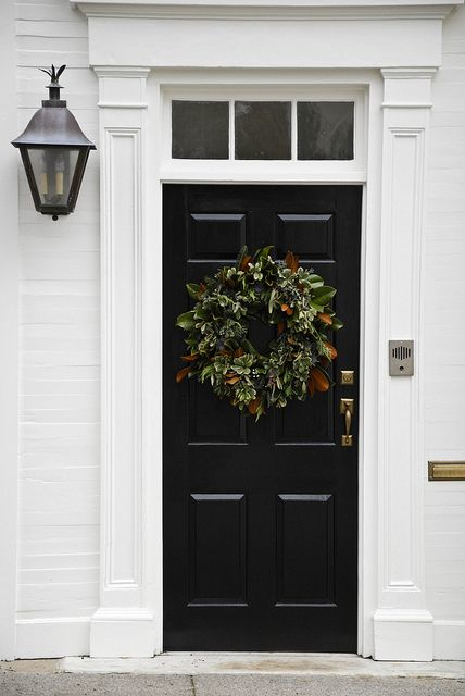 classic entry | black door, white trim, transom, lantern