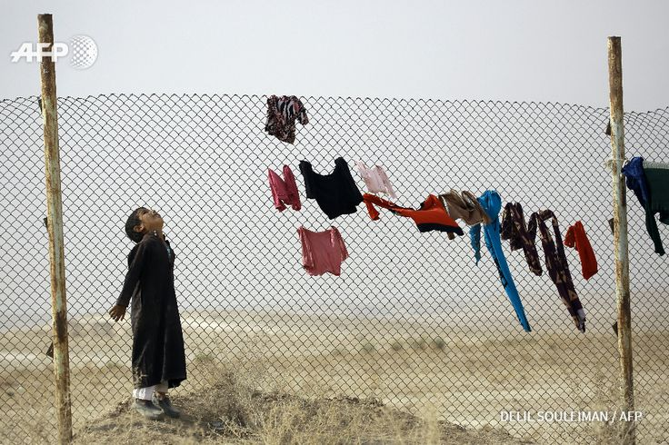 An Iraqi refugee who fled Mosul, the last major Iraqi city under the control of the Islamic State (IS) group, due to the Iraqi government forces offensive to retake the city, looks to the sky at the UN-run Al-Hol refugee camp in Syria's Hasakeh...