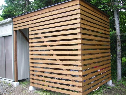 Nice horizontal slats for wood storage area