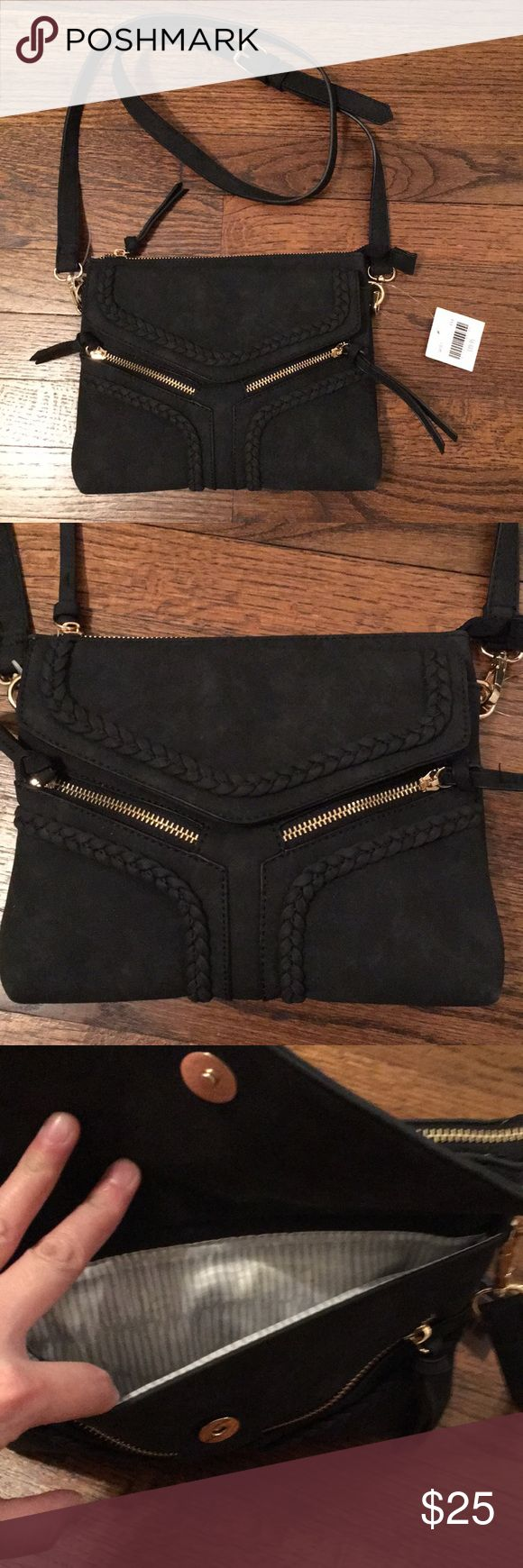 """BRAND NEW black purse BRAND NEW black purse with tags. super cute and has great details. lots of compartments. 10"""" x 8"""" x 2"""" 2 outside zipper pockets, one outside snap pocket, three inside pockets 50"""" shoulder strap-removable and adjustable Altar'd State Bags Crossbody Bags"""