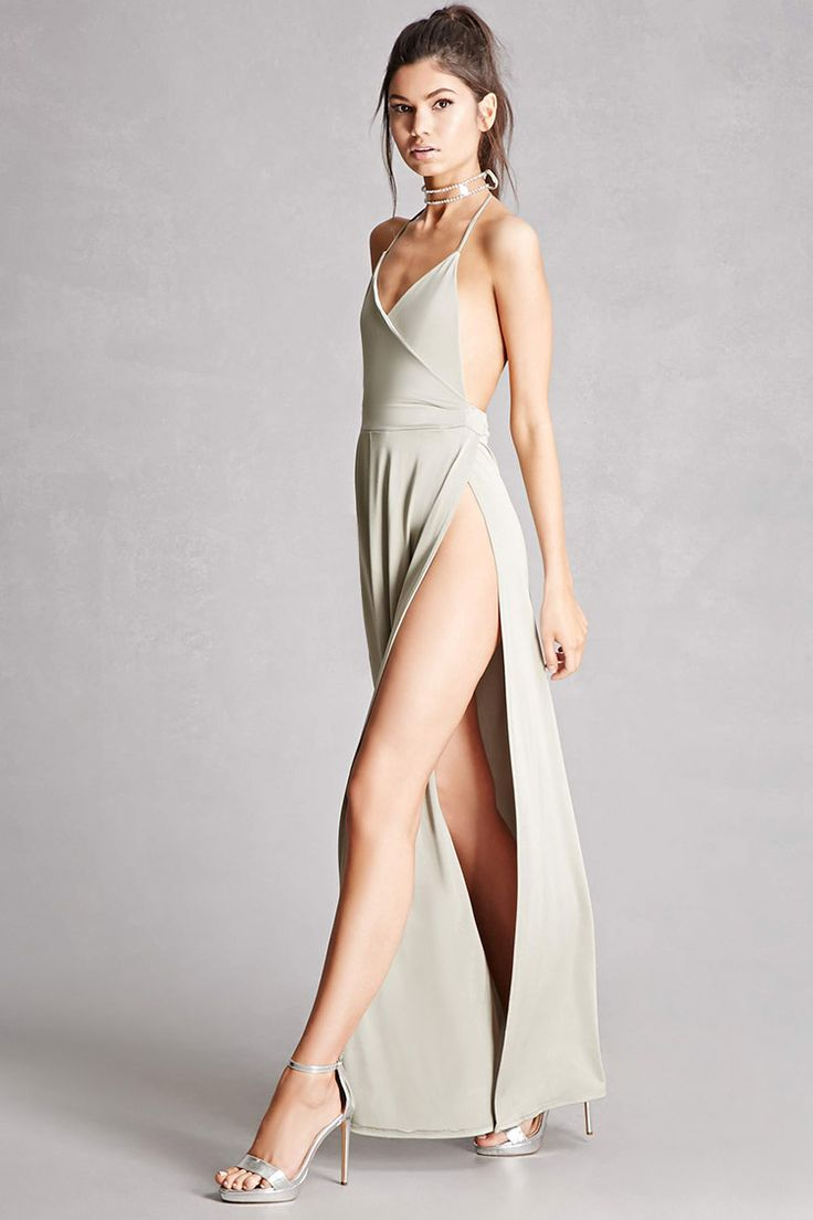 A stretch-knit maxi dress featuring a surplice neckline with self-tie halter straps, a high side slit, asymmetrical front pleating, a backless design, and an elasticized back waist. This is an independent brand and not a Forever 21 branded item.