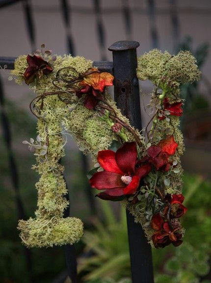 covered with moss and pretty flowers, would be cute on the front door