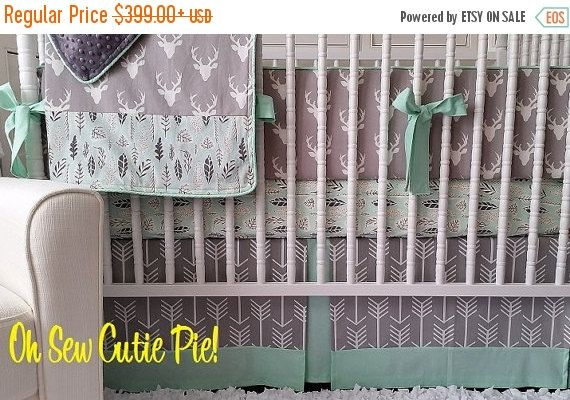 """Timeless, classy and so trendy! This amazing collection of prints it perfect for your new baby! So many possibilities with shades of grey, teal or come up with your favorite color scheme! This set will include the following.... 1 Cotton sheet 1 Crib Skirt (3 sided) Flat design with accent & peekaboo trimmings. 1 Baby/Crib sized blanket (approx. 34 x 43"""") with header & footer and matching minky backing. Monogram included!! 1 Bumper set with piping & ties - Flat style (approx 1"""" thick)"""
