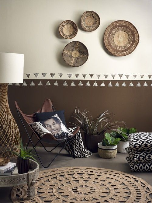 The tribal luxe look with walls Resene Bronze and Resene Triple Wheatfield, a plywood floor in Resene Colorwood Smokey Ash, a coffee table painted with a ragged effect in Resene Double Wheatfield, and a pot in Resene Wood Bark. Styling by Megan Harrison-Turner. Photo by Melanie Jenkins.