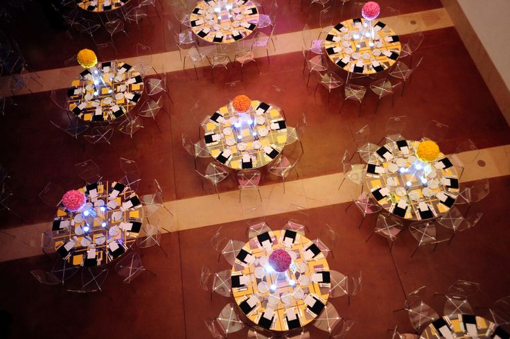 A bird's eye view of a classy techno table setup in the museum's atrium.