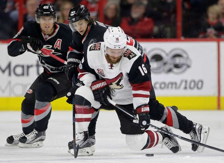 Coyotes control:    Max Domi of the Arizona Coyotes moves the puck as Sebastian Aho, right and Victor Rask of the Carolina Hurricanes pursue during the  second period in Raleigh, NC March 3. Arizona won 4‐2.