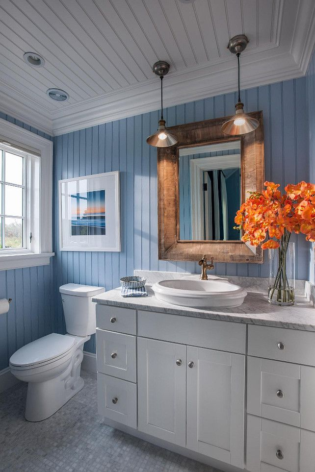 Bathroom Ideas. Coastal bathroom with blue and white motif.  Blue bead board walls bring New England charm into this bathroom, while a Carrara marble vanity top and accent pieces add a touch of elegance.  #Bathroom  #HGTV2015DreamHouse