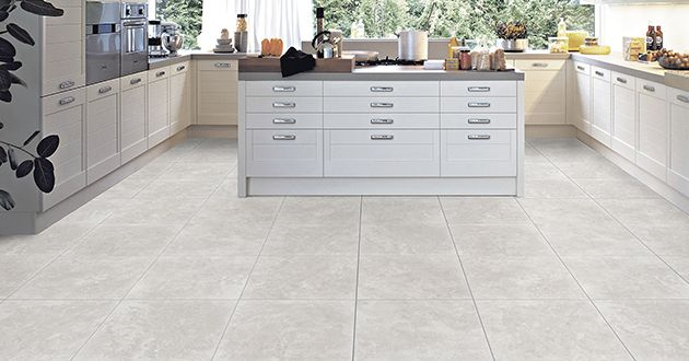 We love a contemporary twist in a traditional style. Here's our version of a modern-meets-classic kitchen. #tiles #design