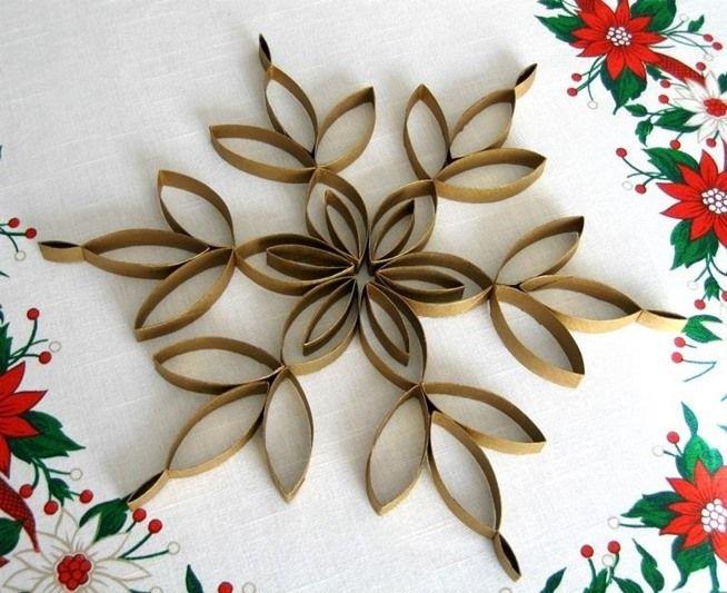 Make cheap snowflake christmas tree topper out toilet paper tubes.w654