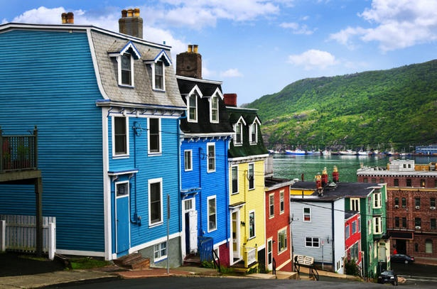 A street with colourful houses near ocean in St. John's, Newfoundland. Would be interested to go there sometime...